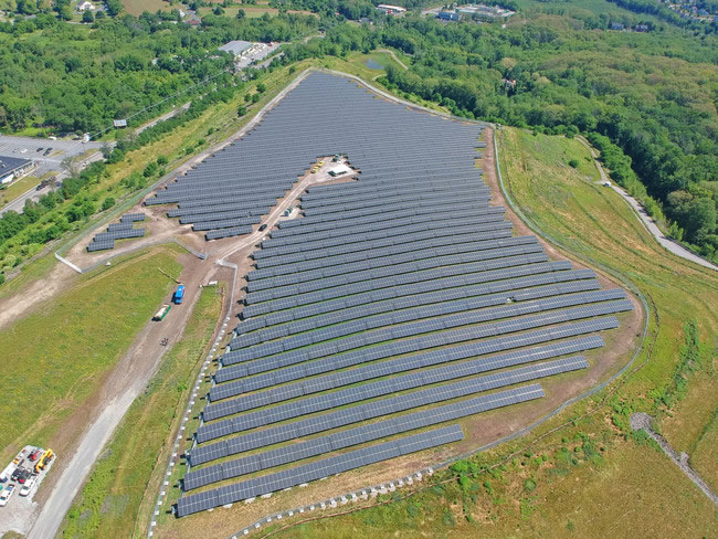 Shrewsbury Landfill Solar Project installed with Solar FlexRack ballasted Pre-Cast mounting solution.